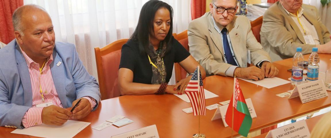 Denise Thomas speaks in a meeting with Belorussian economic developers in the Mogilev region.