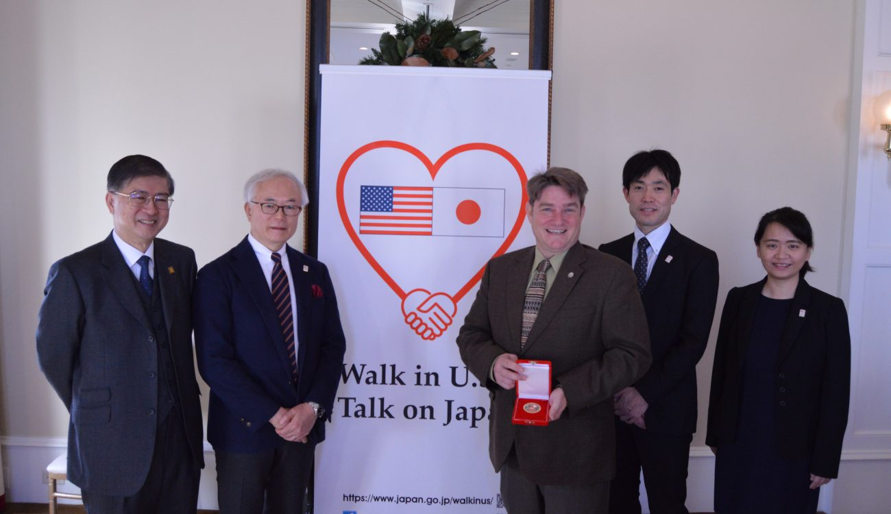 The presenting members of the Walk in U.S. Talk on Japan delegation stand with Arkansas Secretary of State, Mark Martin at the Capitol Hotel in Little Rock on Monday, Dec. 10. From left to right Dr. Kazutomo Irie, Prof. Tomohiko Taniguchi, Mark Martin, Koji Uenoyama, and Xiaojing Zhou.