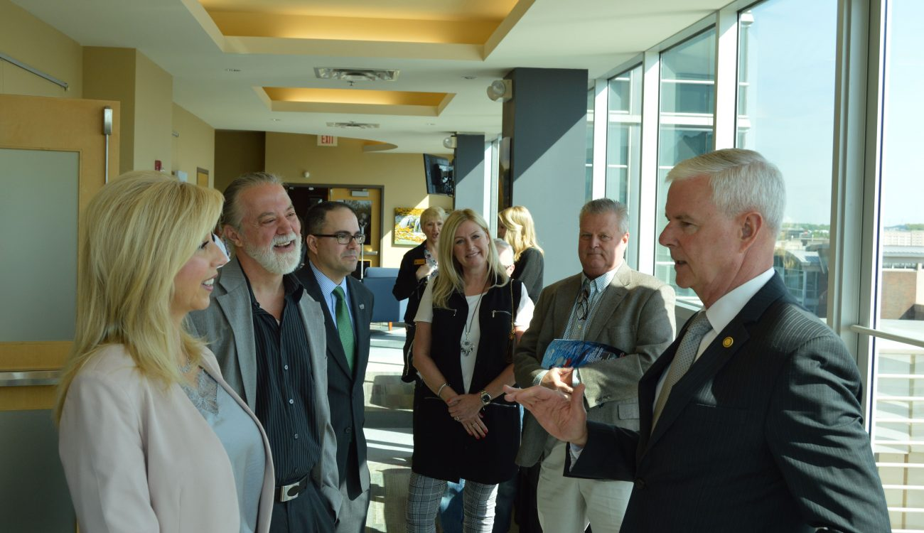 Rep. Steve Womack visits with Tasha Sinclair of Lycus, Ltd.,Flip Kindberg of SkyGenie and Steve Cherry of Kanooler Products before the trade briefing at the World Trade Center Arkansas in Rogers.