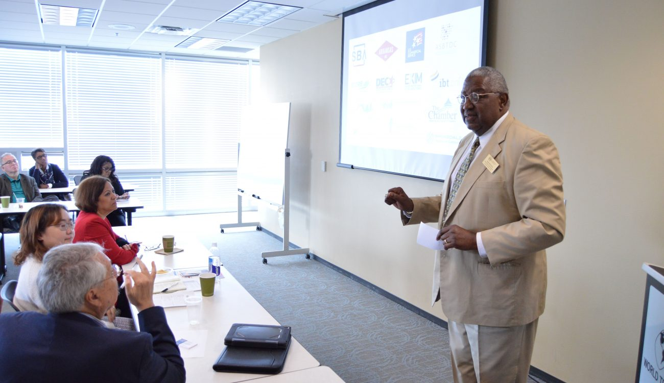 Reginald Harley, Regional Export Finance Manager at the Office of International Trade for the U.S. Small Business Administration speaks to a room full of local businesses on export financing programs available through the SBA. Harley was among the many experts and organization representatives in attendance at the Export Fair.