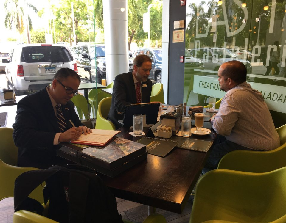 Melvin Torres (left) of the World Trade Center Arkansas and Doug Brooks (center) speak to an interested buyer in Panama during the Trade Mission.