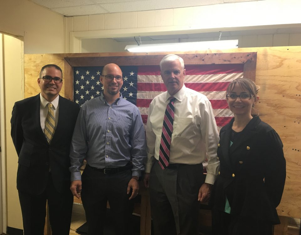 Melvin Torres, Director of Western Hemisphere Trade (left), stands with World Trade Center Arkansas client Chris Tedder, CEO of Clinger Holsters (center left), Congressman Steve Womack (center right) and Sherry Tedder COO of Clinger Holsters (right).