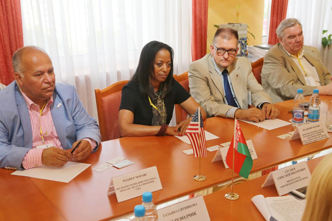 Denise Thomas speaks in a meeting with Belorussian economic developers in the Mogilev region.
