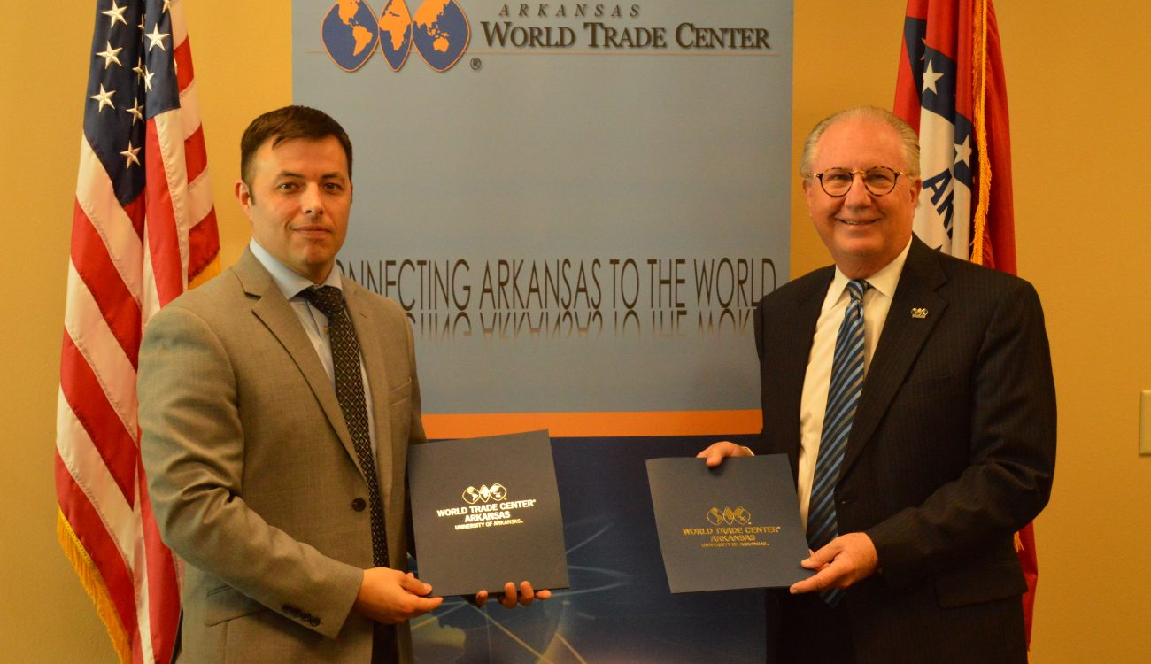 Small Business Administration Arkansas District Director Edward Haddock (left) stands with World Trade Center Arkansas President and CEO Dan Hendrix (right) after the signing of the Strategic Alliance Memorandum on Wednesday, October 10, 2018.