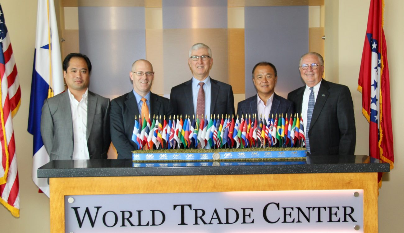 Former. Asst. U.S. Trade Representative Tim Stratford (center) stands with Ben Walters (left) and Mark Hamer (center-left) of the Arkansas Economic Development Commission's Global Business Development Team and World Trade Center Arkansas President and CEO Dan Hendrix (right) and Senior Director of Global Trade Strategy, Boon Tan (center-right).